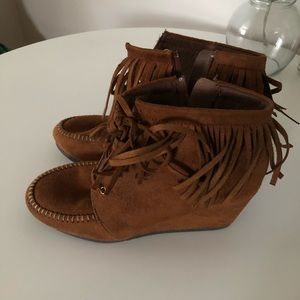 Leather high heeled booties w/ fringe
